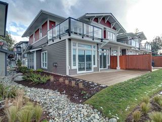 "Photo 1: 5927 BEACHGATE Lane in Sechelt: Sechelt District Townhouse for sale in ""Edgewater"" (Sunshine Coast)  : MLS®# R2328680"