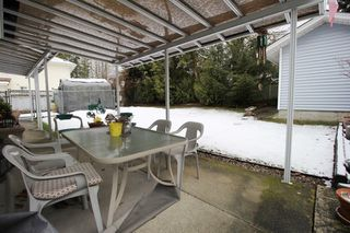"""Photo 12: 7433 142 Street in Surrey: East Newton House for sale in """"Newton"""" : MLS®# R2346790"""