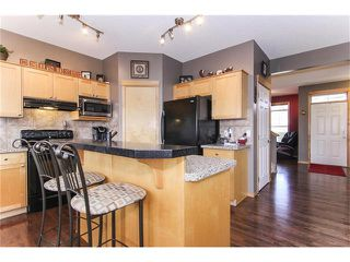 Photo 13: 381 ELGIN Way SE in Calgary: McKenzie Towne House for sale : MLS®# C4036653