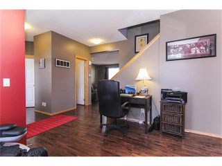 Photo 7: 381 ELGIN Way SE in Calgary: McKenzie Towne House for sale : MLS®# C4036653