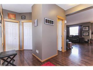 Photo 4: 381 ELGIN Way SE in Calgary: McKenzie Towne House for sale : MLS®# C4036653