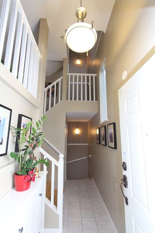 Photo 2: 49 6700 Rumble Street in Francisco Lane: Home for sale