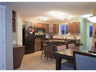 Photo 3: 208 CIMARRON VISTA Way: Okotoks House for sale : MLS®# C4091075