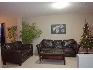 Photo 10: 208 CIMARRON VISTA Way: Okotoks House for sale : MLS®# C4091075