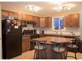 Photo 2: 208 CIMARRON VISTA Way: Okotoks House for sale : MLS®# C4091075