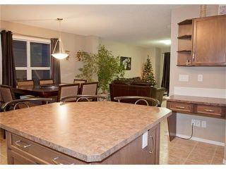 Photo 4: 208 CIMARRON VISTA Way: Okotoks House for sale : MLS®# C4091075