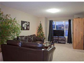 Photo 8: 208 CIMARRON VISTA Way: Okotoks House for sale : MLS®# C4091075