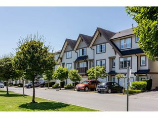 """Photo 1: 91 20540 66 Avenue in Langley: Willoughby Heights Townhouse for sale in """"Amberleigh"""" : MLS®# R2191971"""