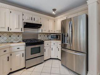 Photo 11: 32 COACH SIDE Place SW in Calgary: Coach Hill House for sale : MLS®# C4140618