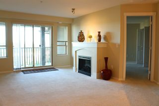 """Photo 2: 408 3110 DAYANEE SPRINGS BL Boulevard in Coquitlam: Westwood Plateau Condo for sale in """"LEDGEVIEW"""" : MLS®# R2309154"""