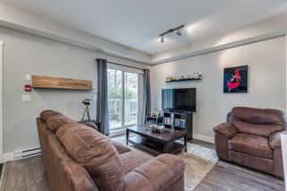 "Photo 9: 103 2110 ROWLAND Street in Port Coquitlam: Central Pt Coquitlam Condo for sale in ""AVIVA"" : MLS®# R2432281"