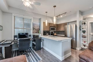 "Photo 7: 103 2110 ROWLAND Street in Port Coquitlam: Central Pt Coquitlam Condo for sale in ""AVIVA"" : MLS®# R2432281"