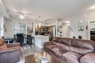 "Photo 10: 103 2110 ROWLAND Street in Port Coquitlam: Central Pt Coquitlam Condo for sale in ""AVIVA"" : MLS®# R2432281"
