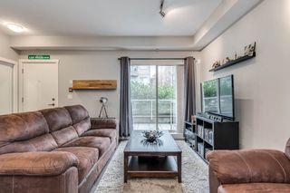 "Photo 8: 103 2110 ROWLAND Street in Port Coquitlam: Central Pt Coquitlam Condo for sale in ""AVIVA"" : MLS®# R2432281"