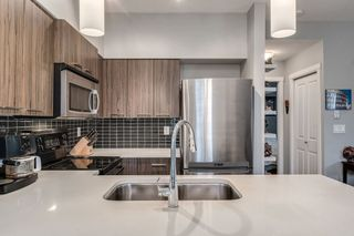 "Photo 5: 103 2110 ROWLAND Street in Port Coquitlam: Central Pt Coquitlam Condo for sale in ""AVIVA"" : MLS®# R2432281"