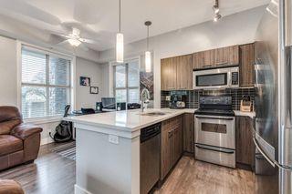 "Photo 6: 103 2110 ROWLAND Street in Port Coquitlam: Central Pt Coquitlam Condo for sale in ""AVIVA"" : MLS®# R2432281"