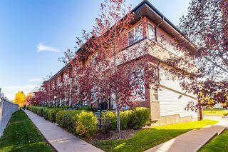 Main Photo: 83 ASPEN HILLS Terrace SW in Calgary: Aspen Woods Row/Townhouse for sale : MLS®# A1039742