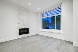 Photo 3: 7699 ULSTER Street in Burnaby: Burnaby Lake 1/2 Duplex for sale (Burnaby South)  : MLS®# R2509034