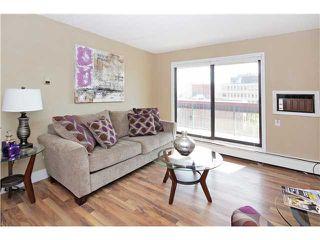 Photo 3: 708 735 12 Avenue SW in Calgary: Connaught Condo for sale : MLS®# C3637632