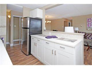 Photo 10: 708 735 12 Avenue SW in Calgary: Connaught Condo for sale : MLS®# C3637632
