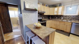 Photo 11: Beautiful remodeled 1.5 storey home for sale in the heart of West Kildonan