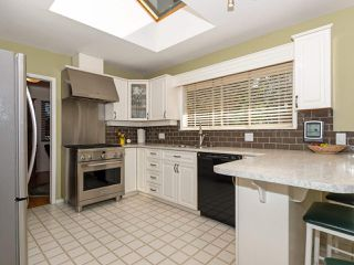 Photo 3: 1614 GREENMOUNT Avenue in Port Coquitlam: Oxford Heights House for sale : MLS®# R2351074