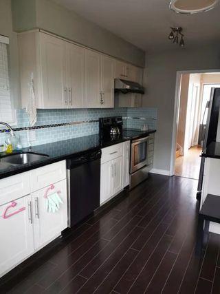 """Photo 2: 6176 SERVICE Street in Burnaby: Upper Deer Lake House for sale in """"UPPER DEER LAKE"""" (Burnaby South)  : MLS®# R2422484"""