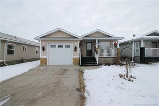 Main Photo: 13 Baywood Place in Sylvan Lake: SL Lighthouse Point Residential Condo for sale : MLS®# CA0184367