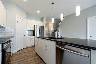 Photo 4:  in Edmonton: Zone 30 House Half Duplex for sale : MLS®# E4205437
