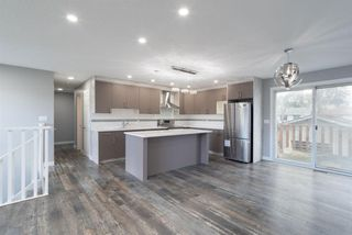 Photo 2: 5719 PINEPOINT Drive NE in Calgary: Pineridge Detached for sale : MLS®# A1031036