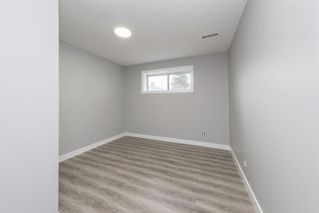 Photo 5: 5719 PINEPOINT Drive NE in Calgary: Pineridge Detached for sale : MLS®# A1031036