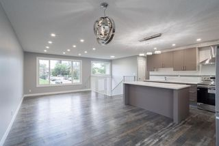 Photo 3: 5719 PINEPOINT Drive NE in Calgary: Pineridge Detached for sale : MLS®# A1031036