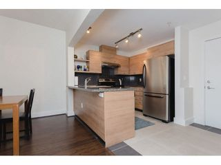 """Photo 5: 117 6628 120TH Street in Surrey: West Newton Condo for sale in """"THE SALUS"""" : MLS®# F1431111"""