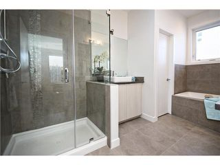 Photo 9: 2 4733 17 Avenue NW in Calgary: Montgomery Townhouse for sale : MLS®# C3651409