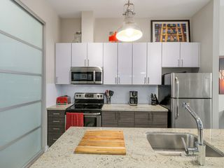 "Photo 5: 106 3688 INVERNESS Street in Vancouver: Knight Condo for sale in ""Charm"" (Vancouver East)  : MLS®# R2045908"
