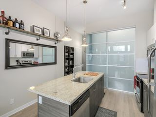 "Photo 3: 106 3688 INVERNESS Street in Vancouver: Knight Condo for sale in ""Charm"" (Vancouver East)  : MLS®# R2045908"