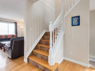 Photo 13: 57 ROCKBLUFF PL NW in Calgary: Rocky Ridge House for sale : MLS®# C4113823