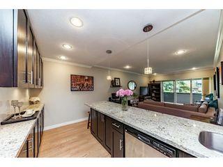 "Photo 1: 111 3451 SPRINGFIELD Drive in Richmond: Steveston North Condo for sale in ""Admiral Court"" : MLS®# R2275006"