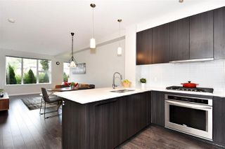 "Photo 1: 120 9311 ALEXANDRA Road in Richmond: West Cambie Condo for sale in ""Alexandra Court"" : MLS®# R2322864"