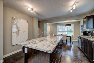 Photo 10: 257 PANTEGO Lane NW in Calgary: Panorama Hills Row/Townhouse for sale : MLS®# A1018119