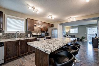 Photo 8: 257 PANTEGO Lane NW in Calgary: Panorama Hills Row/Townhouse for sale : MLS®# A1018119