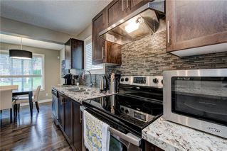 Photo 11: 257 PANTEGO Lane NW in Calgary: Panorama Hills Row/Townhouse for sale : MLS®# A1018119