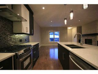 Photo 10: 4011 1 Street NW in CALGARY: Highland Park Residential Attached for sale (Calgary)  : MLS®# C3594616