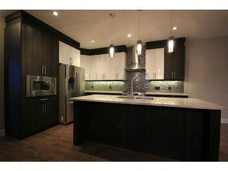 Photo 8: 4011 1 Street NW in CALGARY: Highland Park Residential Attached for sale (Calgary)  : MLS®# C3594616