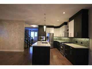 Photo 7: 4011 1 Street NW in CALGARY: Highland Park Residential Attached for sale (Calgary)  : MLS®# C3594616