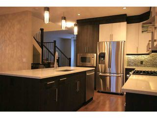 Photo 9: 4011 1 Street NW in CALGARY: Highland Park Residential Attached for sale (Calgary)  : MLS®# C3594616