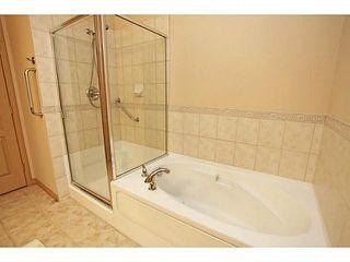 Photo 13: 3104 LAKE FRASER Court SE in Calgary: Lake Bonavista Condo for sale : MLS®# C3651453