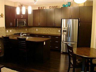 Photo 4: 1206 10 AUBURN BAY Avenue SE in Calgary: Auburn Bay Townhouse for sale : MLS®# C3580088