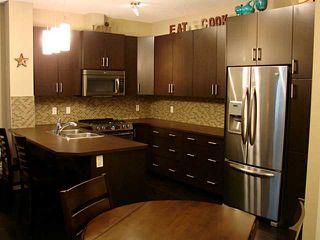 Photo 2: 1206 10 AUBURN BAY Avenue SE in Calgary: Auburn Bay Townhouse for sale : MLS®# C3580088