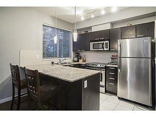 "Photo 1: 210 10455 UNIVERSITY Drive in Surrey: Whalley Condo for sale in ""D'COR BUILDING B"" (North Surrey)  : MLS®# F1436440"